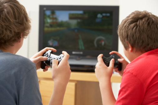 Two Boys Playing With Game Console