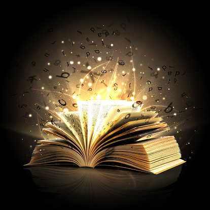 Magic book with magic lights and letters