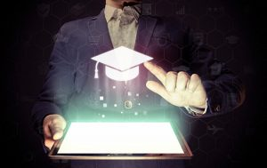 Image of a man with a tablet in his hands. He presses on the icon graduation hat cap. Online education concept, choose of career.