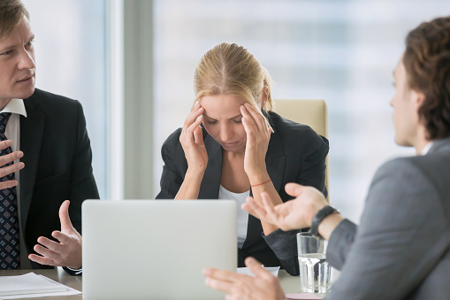 Stressing atmosphere at business meeting